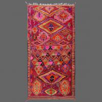Few carpets cause such a great impression as this prestigious vintage carpet from the Boujad, partly because of its size but mainly because of the wonderful selection burgundy, mauve and orange colors in such a fantastic pattern.