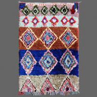 A diminutive but smart Azilal carpet with its bands of clours and diamond shapes