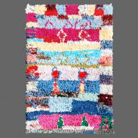 The artistic pattern on this Boucherouite rug offers cubist art in wonderfully Berber way